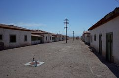 An eerie street in the abandoned Humberstone saltpeter works. This abandoned nitrate town was extremely important for the early economy of Chile royalty free stock photography