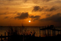 Eerie. The sunset casts an eerie glow along the bay royalty free stock photography