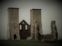 An eerie view of Reculver Towers. Reculver Towers, a striking landmark along the Kent coast Royalty Free Stock Images
