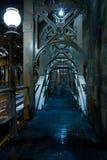 Eerie Walkway. Eerie long Walkway on desrted bridge footpath early in morning Stock Photos