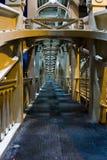 Eerie Walkway. Eerie long Walkway on desrted bridge footpath early in morning Royalty Free Stock Photos