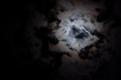 Eerie white clouds at night. Background of eerie white clouds with space for copy against a black night sky royalty free stock images