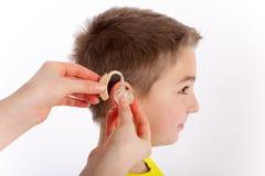 Eerste gehoorapparaat stock afbeeldingen