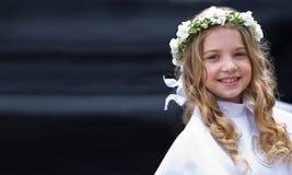 Eerste Heilige Communie die - gigl glimlacht Royalty-vrije Stock Afbeelding