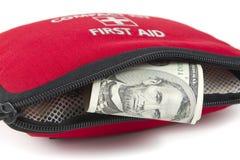 Eerste hulpuitrusting met dollar Stock Afbeeldingen