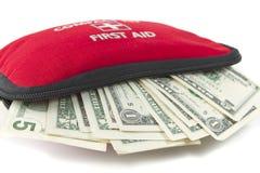 Eerste hulpuitrusting met dollar Stock Foto