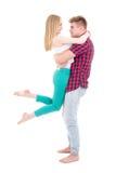 Eerste liefdeconcept - jonge mens die haar meisje geïsoleerd o houden Royalty-vrije Stock Fotografie