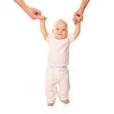 Eerste stappen. Baby die leren te lopen, Stock Foto's