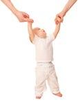 Eerste stappen. Baby die leren te lopen Stock Fotografie