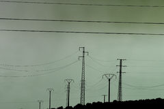 Eery landscape. Polluted landscape with electricity pylons and wires Royalty Free Stock Photo