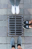 Eet around Sewer manhole Stock Photography