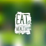 Eet gezond vectorembleem met hand het van letters voorzien Natuurvoedingetiket op onduidelijk beeldachtergrond voor veganistkoffi Royalty-vrije Stock Foto