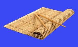 Eetstokjes en bamboemat royalty-vrije stock foto