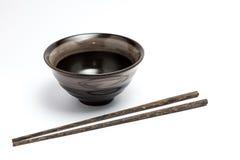 Eetstokjes en Japanse stijlkom Stock Afbeeldingen