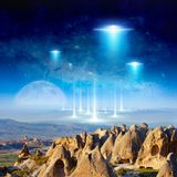 Eextraterrestrial aliens spaceship fly above surreal terrain. Amazing fantastic background - extraterrestrial aliens spaceship fly above surreal terrain, full stock image
