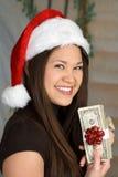 Efectivo de la Navidad y mujer hermosa Foto de archivo libre de regalías
