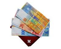 Efectivo y carpeta suizos Imagen de archivo libre de regalías