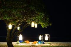 Efecto del bokeh de la noche sobre la playa imagen de archivo libre de regalías
