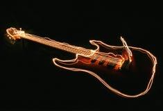 Efecto luminoso de la guitarra eléctrica Fotografía de archivo libre de regalías