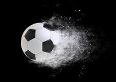 Efeito da velocidade da bola de futebol isolado no preto Imagens de Stock Royalty Free