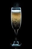 Efervescendo o vidro de Champagne Imagem de Stock Royalty Free