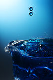 Effect blue water droplets Royalty Free Stock Images