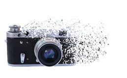 The effect of decay on vintage camera. Vintage camera on a white background with the effect of the decay Stock Photography
