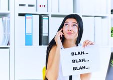 Young businesswoman in the process of useless conversation with the client or boss. Effective communication concept. Effective communication concept. Young stock photo