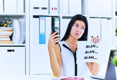 Young businesswoman in the process of useless conversation with the client or boss. Effective communication concept. Effective communication concept. Young royalty free stock photo
