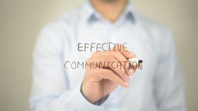 Effective Communication, man writing on transparent screen. High quality stock image