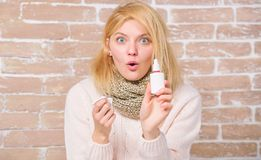 Effective nasal spray. Runny nose and other symptoms of cold. Nasal spray runny nose remedy. Girl sick person hold nasal. Drops and tissue. Allergy concept stock image