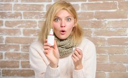 Effective nasal spray. Runny nose and other symptoms of cold. Nasal spray runny nose remedy. Girl sick person hold nasal. Drops and tissue. Allergy concept royalty free stock photography