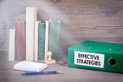 Effective Strategies. Binder on desk in the office. Business backgroundr. Effective Strategies. Binder on desk in the office. Business background royalty free stock photography