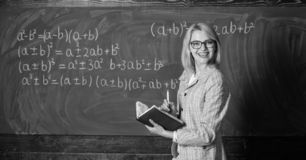 Effective teaching involve acquiring relevant knowledge. Woman teaching near chalkboard in classroom. Qualities that. Make good teacher. Effective teaching royalty free stock photography