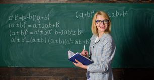 Effective teaching involve acquiring relevant knowledge. Woman teaching near chalkboard in classroom. Qualities that. Make good teacher. Effective teaching royalty free stock photos