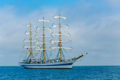 Sailing ship passing in sea in summer. Effective team work. Achieving aims. Effective team work. Sailing ship passing in sea. Achieving aims. Travelling concept royalty free stock image