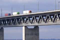 Effective transports. Trucks and train in effective transports on the bridge between Denmark and Sweden royalty free stock photos