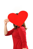 The effective young woman in a red dress with red heart Valentin Stock Images