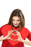 The effective young woman in a red dress with red heart Valentin Royalty Free Stock Images
