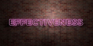 EFFECTIVENESS - fluorescent Neon tube Sign on brickwork - Front view - 3D rendered royalty free stock picture Royalty Free Stock Image