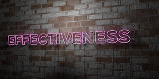 EFFECTIVENESS - Glowing Neon Sign on stonework wall - 3D rendered royalty free stock illustration Stock Photo