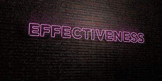 EFFECTIVENESS -Realistic Neon Sign on Brick Wall background - 3D rendered royalty free stock image Royalty Free Stock Images