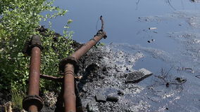 Effects nature from water contaminated with chemicals and oil stock video footage
