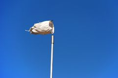 Effects of the Wind. Old weathered windsock against the blue sky Stock Photo