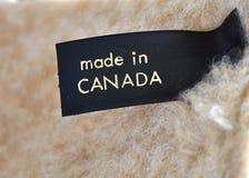 Effectué dans l'étiquette du Canada photos stock