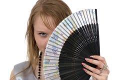 Effectuant à sembler une plus jeune fille et un ventilateur photographie stock libre de droits