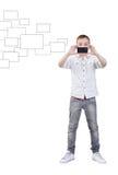 Effectuer des photos avec le dispositif mobile Photographie stock libre de droits