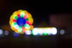 effekt för 50mm bakgrundsblur aktiverar sidan för nattnikkordeltagaren Royaltyfri Foto