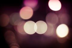effekt för 50mm bakgrundsblur aktiverar sidan för nattnikkordeltagaren Arkivfoto