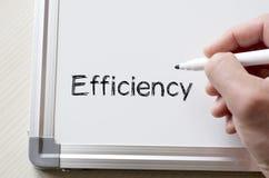 Effektivitet som är skriftlig på whiteboard arkivfoto